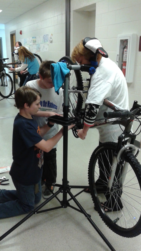 working on their bike 2